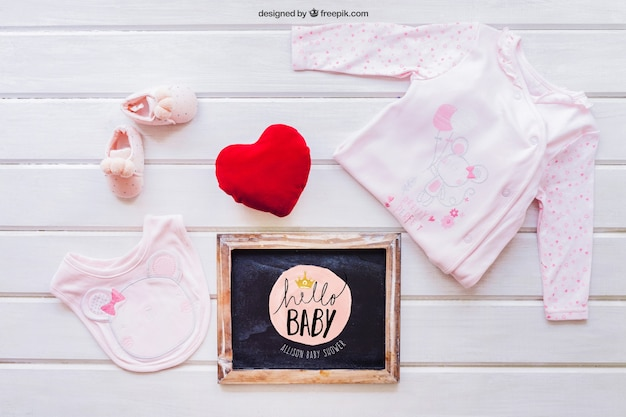 Baby mockup with girl clothes and slate