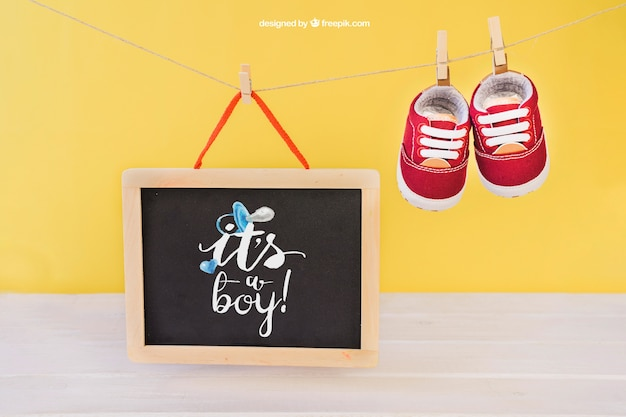 Baby mockup with shoes on clothes peg