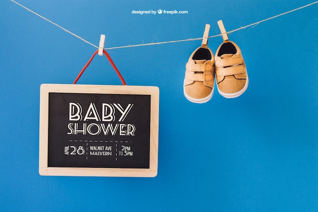 Baby mockup with shoes and slate on clothes line
