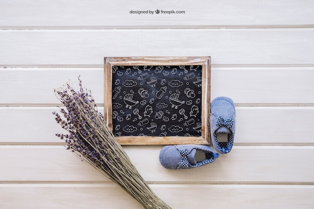 Baby mockup with slate and flower