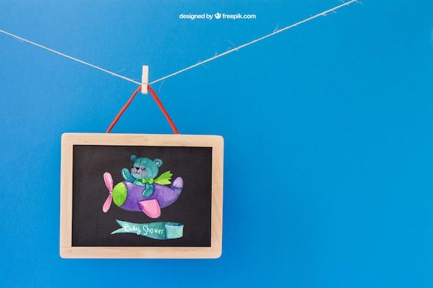 Детский макет со сланцем, висящим на одежде