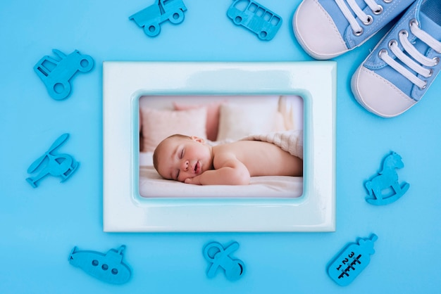 Baby shower decorations with frame and shoes
