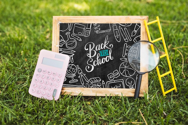 Back to school arrangement on grass mock-up