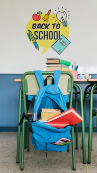 Back to school bag with supplies and wall mock-up
