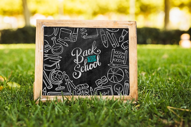 Back to school blackboard on grass mock-up