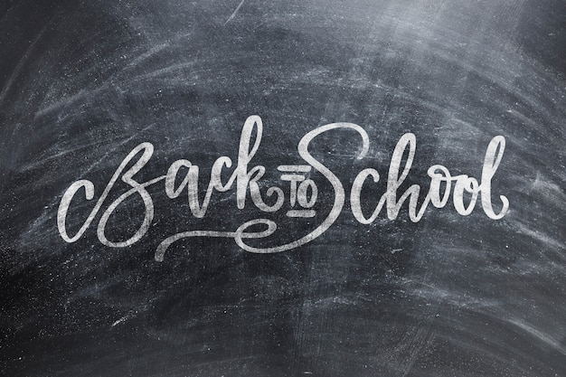 Back to school blackboard with chalk traces