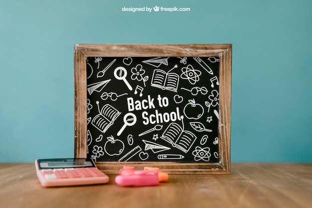 Back to school composition with leaning slate
