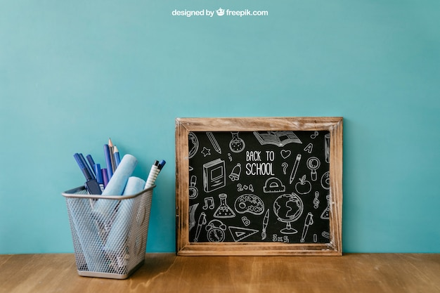 Back to school composition with slate and pens