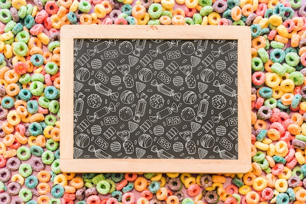Back to school composition with slate and sweets