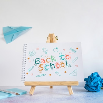 Back to school event with wooden painting easel