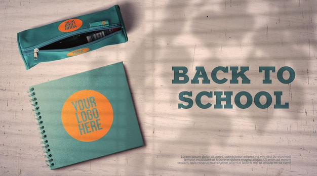 Back to school mockup pencil case and notebook on classroom desk