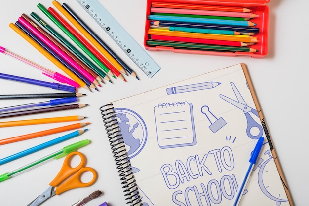 Back to school mockup with notebook and pencils