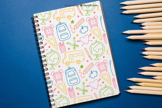 Back to school mockup with notepad and pencils