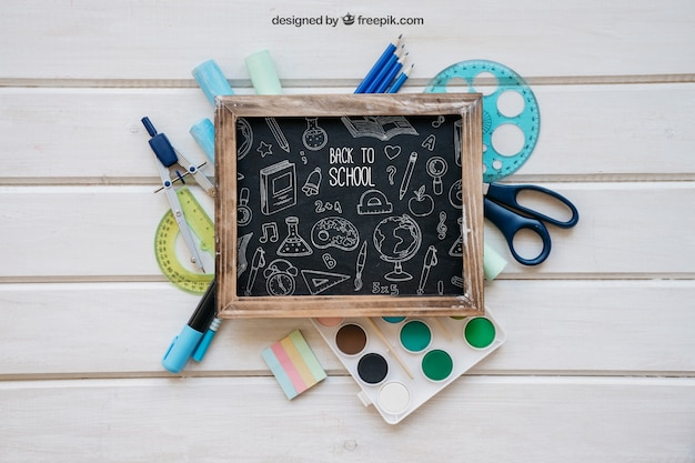 Back to school mockup with slate on school objects