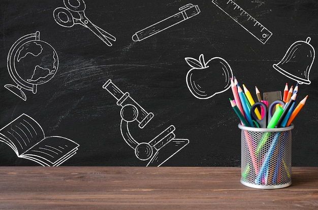 Back to school supplies on blackboard mockup