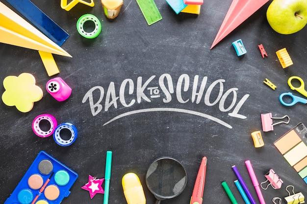 Back to school supplies on blackboard