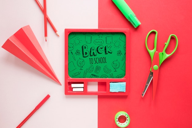 Back to school supplies with green board