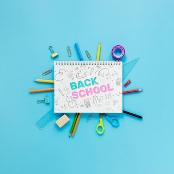 Back to school supplies with notebook and drawing