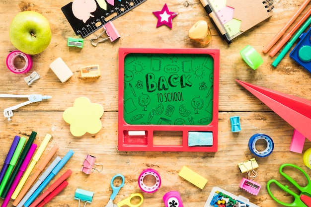 Back to school supplies on wooden background