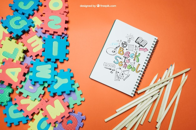 Back to school template with jigsaw and notebook