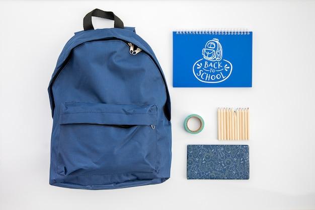 学校に戻る、学生用品のバックパック Premium Psd