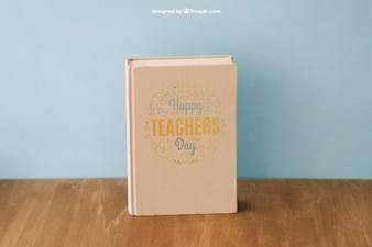 Back to school composition with book on wooden surface