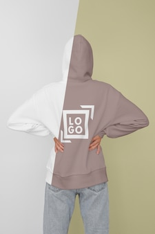 Back view of stylish woman in hoodie Free Psd