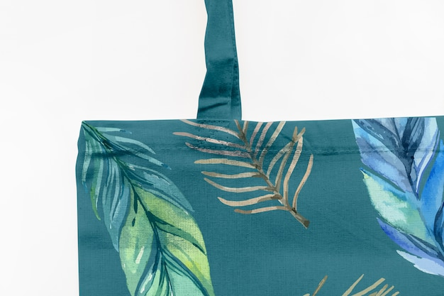 Bag mockup with tropical flowers concept
