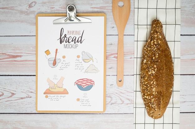 Bakery recipe on clipboard on desk