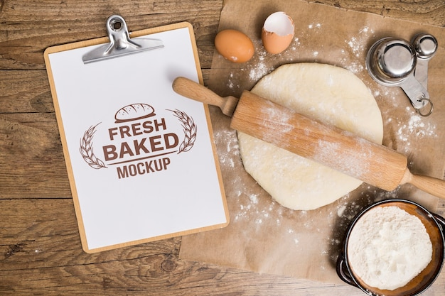 Bakery recipe on clipboard and dough