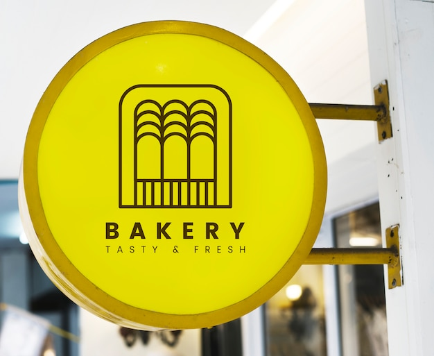 Bakery store's yellow shop sign mockup