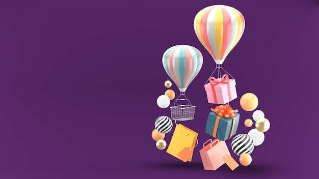 Balloon, gift box and shopping bag surrounded by colorful balls on purple
