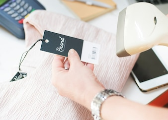 Barcode scanner is scanning the price tag