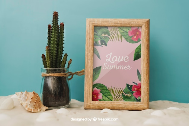Beach concept with cactus and frame