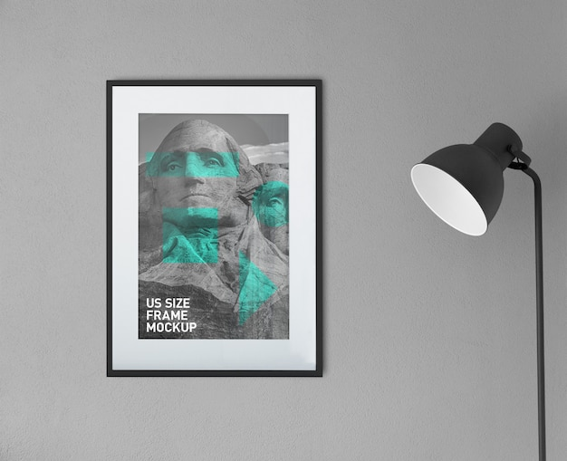 Beautiful clean photo black portrait frame on the simple wall mockup