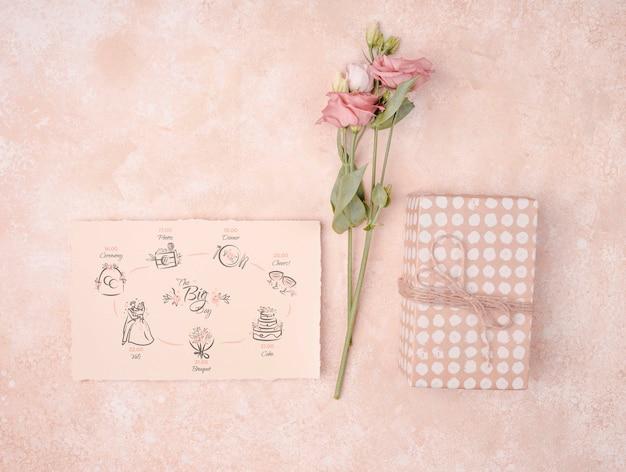 Beautiful flowers with wedding invitation