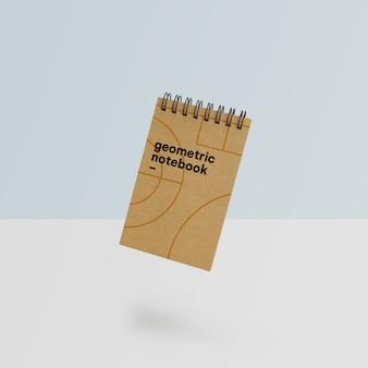 幾何学的なスタイルの美しいノートブックのモックアップpsd