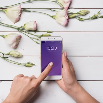 Beautiful smartphone mockup with floral decoration