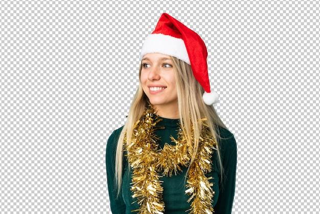 고립 된 크리스마스 모자와 아름 다운 여자