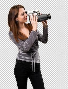 Beautiful young girl filming