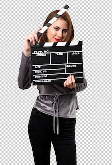 Beautiful young girl holding a clapperboard