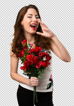 Beautiful young girl holding flowers and shouting