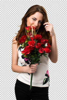 Beautiful young girl holding flowers