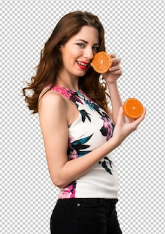 Beautiful young girl holding oranges