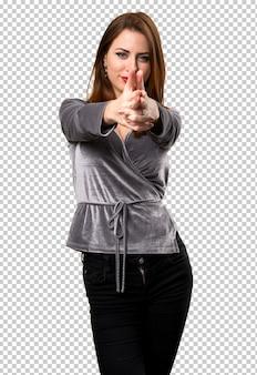 Beautiful young girl making gun gesture