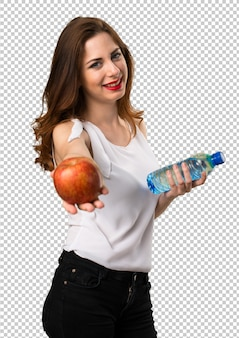 Beautiful young girl with apple and water