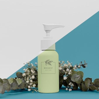 Beauty product bottle with plant mock-up