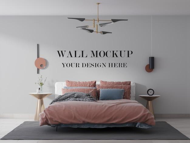 ベッドとランプ付きの寝室の壁のモックアップ