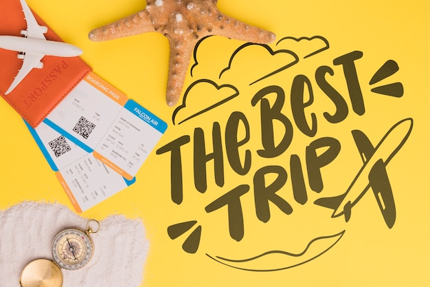 The best trip, lettering with starfish, airplane ticket and compass