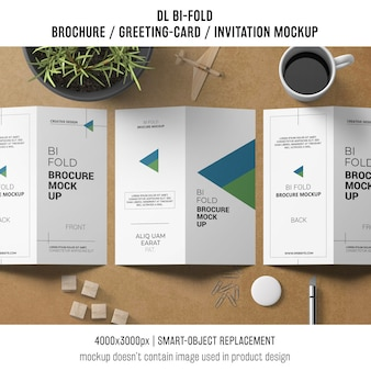 Bi-fold brochure or invitation mockup with still life concept